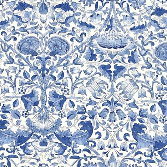 Lodden Fabric A beautiful fabric of scrolling flowers and foliage in china blue on a white background.