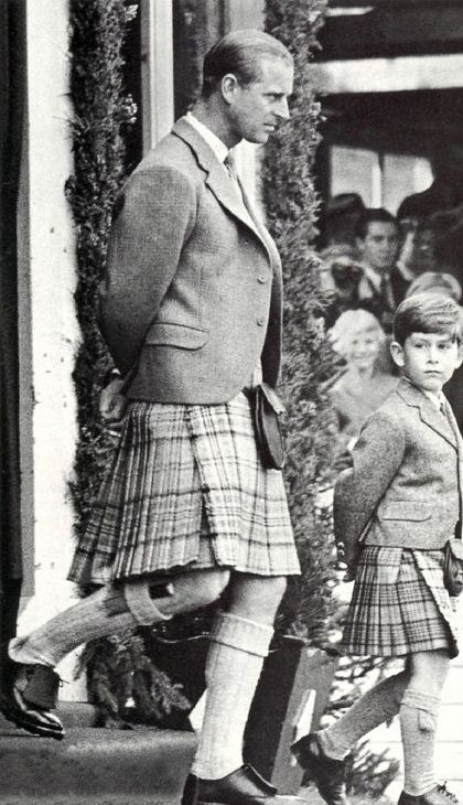 Prince Philip and Prince Charles (age 6) in 1955 ~ Love the way they both have their arms!