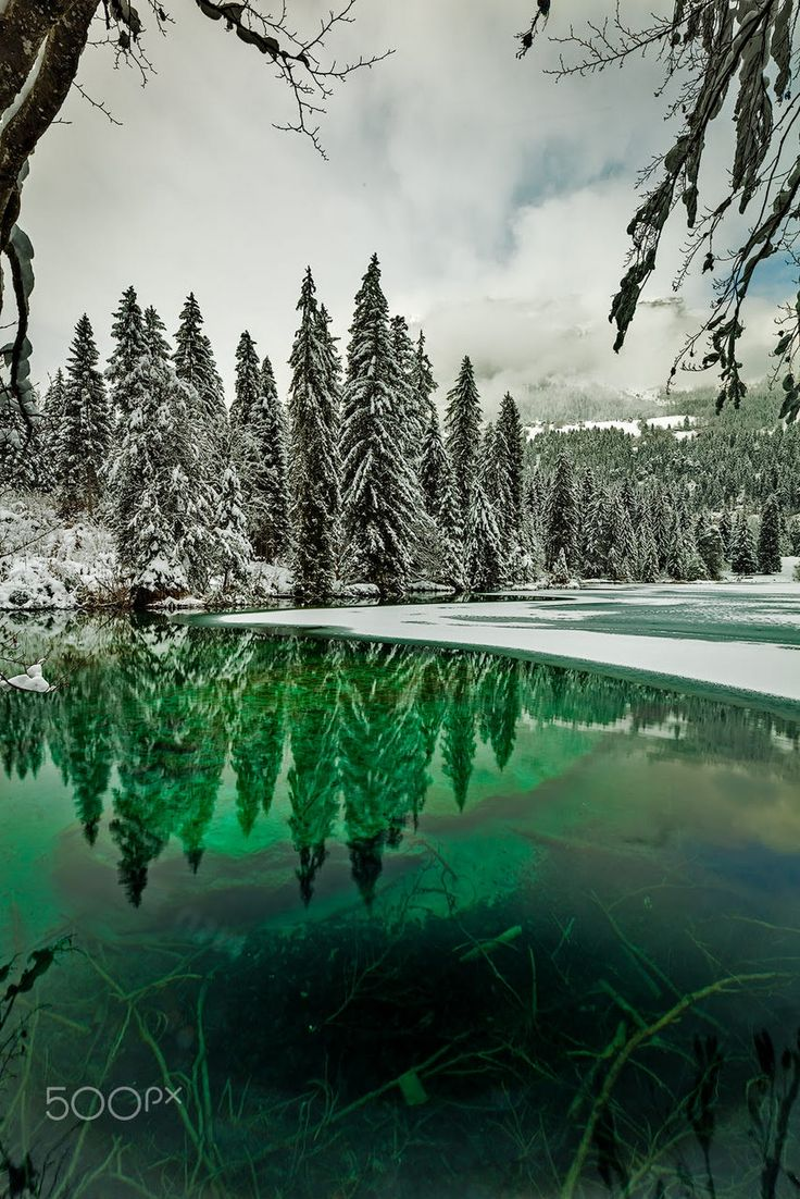 Emerald Water and Snowy Trees