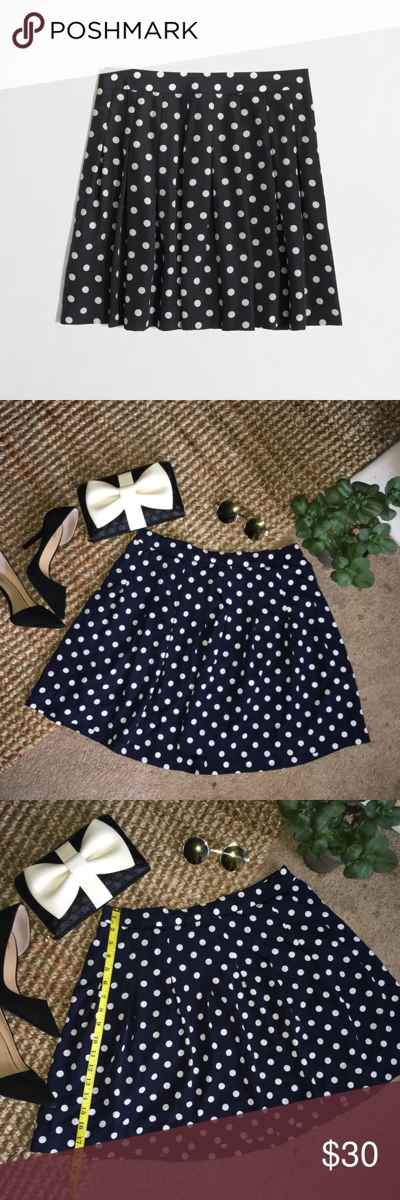 """J.Crew Factory Navy&White Polka Dot Pleated Skirt In excellent condition! J.Crew Factory Navy&White Polka Dot Pleated Skirt. Size 6. Length is about 18.5"""". Gently used. Damage stain and smoke free. Reasonable offers are welcome J. Crew Factory Skirts Circle & Skater"""