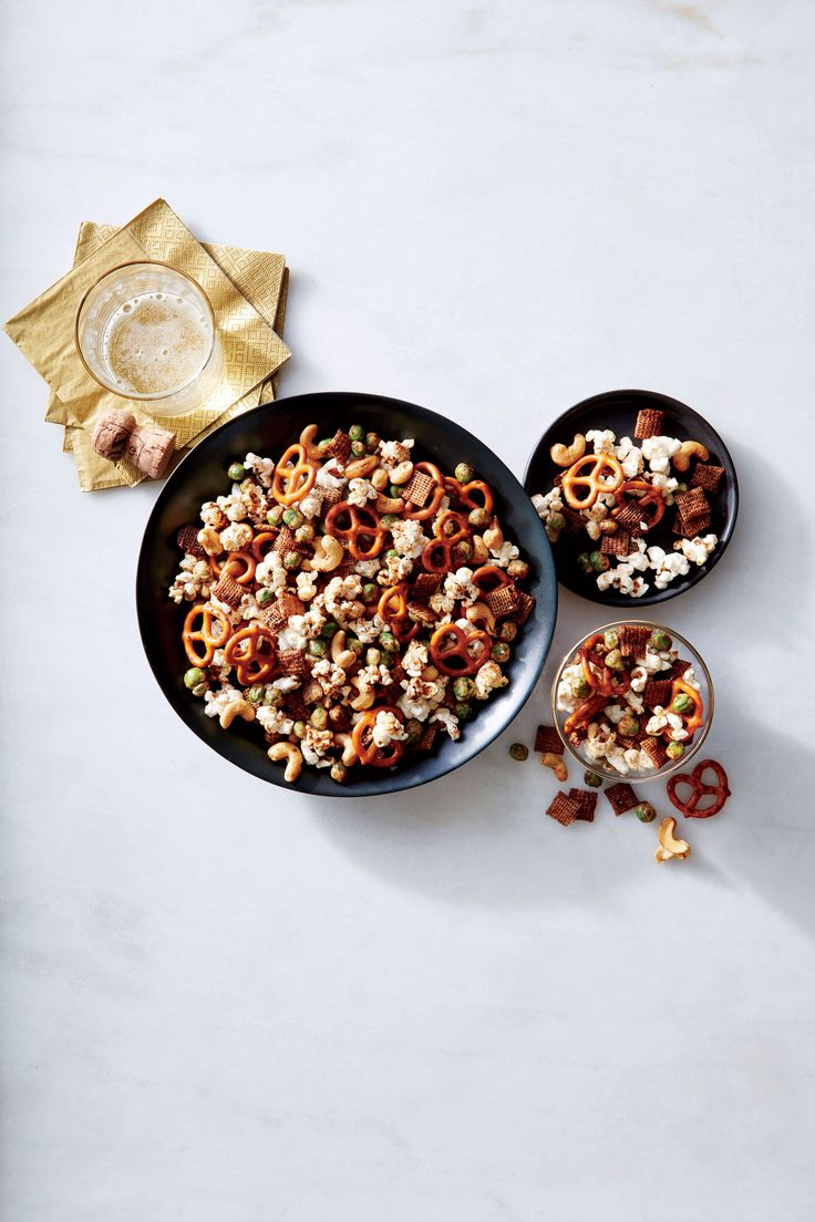 If any one dish is devoured quickly and constantly (usually by the fistful) throughout the holiday, it's snack mix. Consisting of salty nuts, pretzels, and cereal doused with a Worcestershire and butter, this innocent munchie racks up sodium and calories quickly. Our healthier version gives you all the salt, crunch, and bold spices of the original with the addition of whole-grain popcorn, toasty whole-wheat cereal, and spicy wasabi peas. The peas inspired an Asian track with toasty sesame…