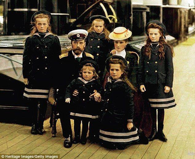 Russian Tsar Nicholas II and Tsarina Alexandra, with their five children dressed in sailing outfits (clockwise from left: Olga, Maria, Tatiana, Anastasia, Alexei). Circa, 1907.