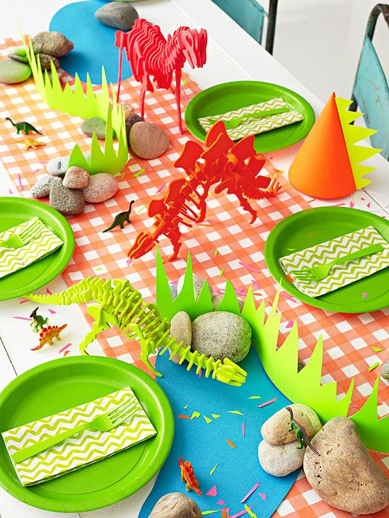 Set out colorful plastic dinosaur toys and spiky paper hats for a fun prehistoric birthday bash. (This is the birthday party every kid DREAMS of having!) http://www.parents.com/fun/birthdays/ideas/neon-dinosaur-birthday-party/?socsrc=pmmpin130410bpNeonDinosaur