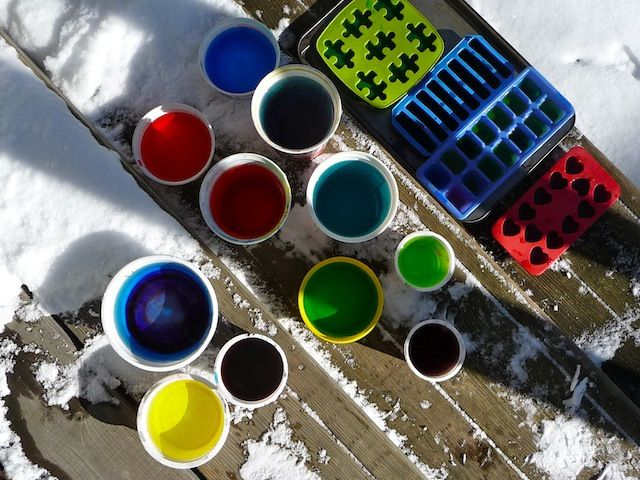 Playing with colored ice. Good outdoor winter activity!