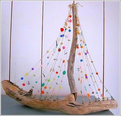 Driftwood and Color Bead boat..but I think U could turn this into A CHRISTMAS TREE. Love the little round eye screws at the bottom..put a cute sparkly STAR on TOP! More
