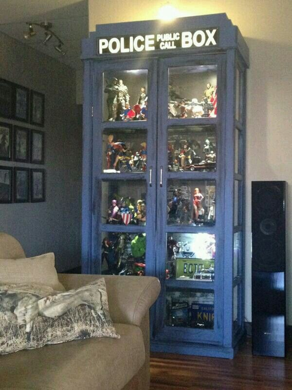TARDIS Cabinet Filled With Action Figures And Memorabilia... I Want It.