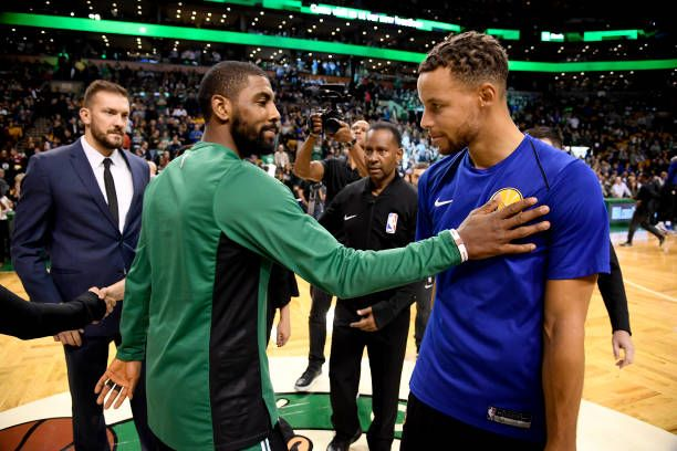 Kyrie Irving of the Boston Celtics and Stephen Curry of the Golden State Warriors talk before the game on November 16 2017 at the TD Garden in Boston...