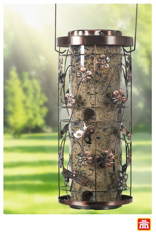 This whimsical bird feeder is like no other! It has 4lb seed capacity, has 8 feeding ports and has a unique antique copper finish. Birds will love coming to your backyard.
