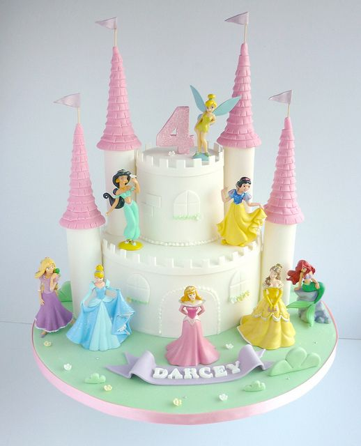 Disney Princesses castle birthday cake with cake figurines via https://www.flickr.com/photos/swirlsbakery/13040141743/in/photostream/