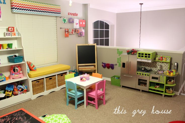 Ah-mazing playroom!! Lots of DIY! Especially love the ideas of chalkboard top table and the DIY poufs.