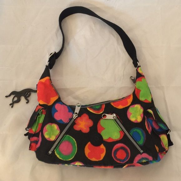 Kipling handbag Kipling handbag. Excellent condition. Small stain shown picture. I have not tried to wash it off. No pay pal or trades. Price firm. Kipling Bags