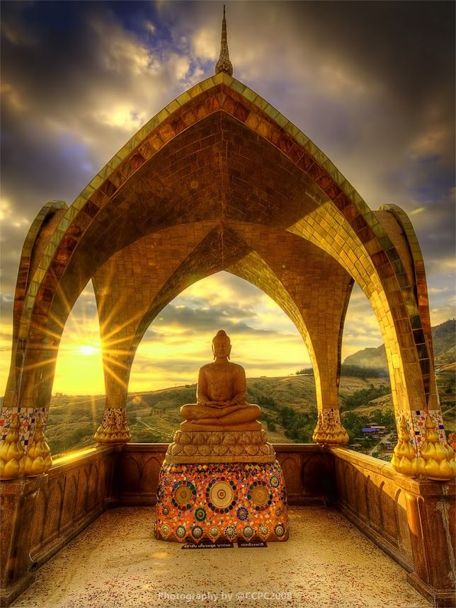 Sunset behind Buddha sculpture at Phasornkaew (Wat Phrathat Phakaew), Phetchabun prov, Thailand. Few tourists make it that way.. only backpackers with enough time travelling between the Maekong area in the east and the Sukothai area in the west. Gorgeous region though.