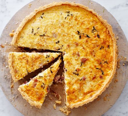 Make quiche Lorraine to perfection every time with this easy recipe for a crisp pastry base and rich smoked bacon, cheese and thyme filling