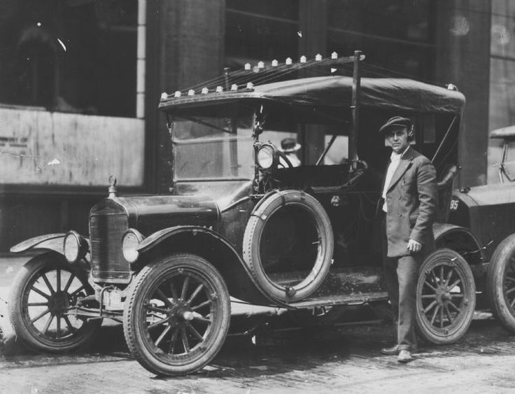 Detroit (MI) -  One of the first police cars equipped with radio is shown off in 1935 by Patrolman Walter Stick. The police station was KOP. (The Detroit News)