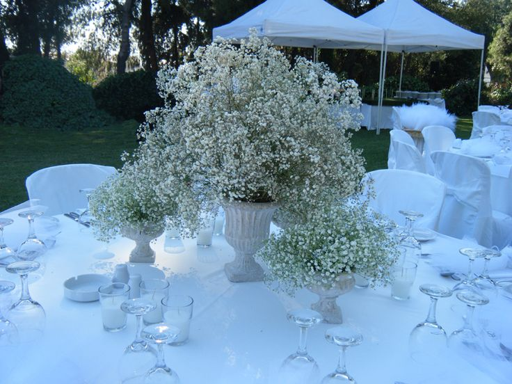 Baby's breath centerpiece for the bride's and groom's table. Chic