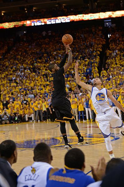 Kyrie Irving of the Cleveland Cavaliers shoots a three point basket to win the game against the Golden State Warriors during the 2016 NBA Finals Game...