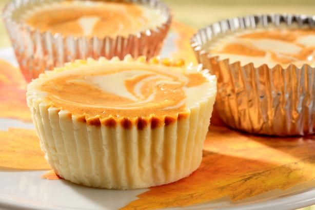 Individual Swirled Pumpkin Cheesecakes: Pamper guests this holiday season with individual delights. An elegant fusion of two fall favorites, pumpkin pie and gingerbread, makes these mini cheesecakes irresistible. [Sponsored by Nestle Coffee-Mate]