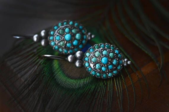 This is an antique european snake eye turquoise (persian turquoise) classical pave design solid silver earring. It is very old, I think from around the 1800s, but I am not exactly sure when it was made. I also have a similar bracelet for sale in the shop! Various size (2-3.5 mm) round