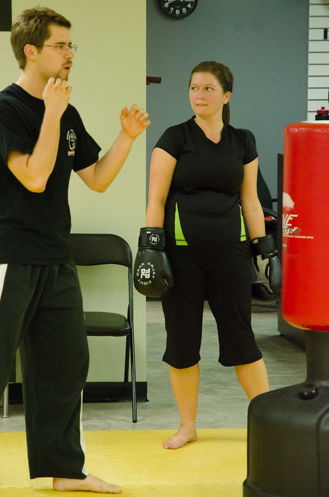 Sensei Logan demonstrating proper punching for the cardio kickboxing class