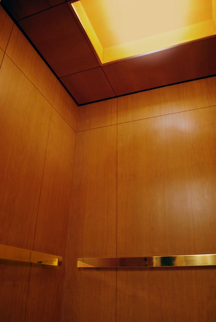 wall to wall wood veneer panels afford this luxury hotel and