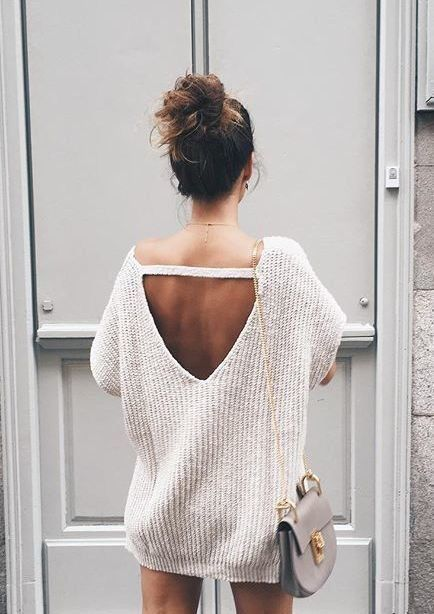Not sure where her pants are but the sweater and purse
