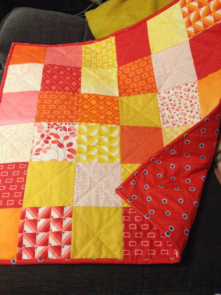Made in a day with precut cotton squares, cotton backing and home made binding, result!