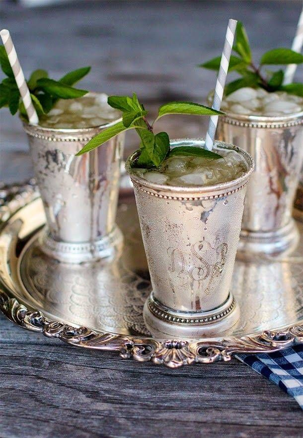 mint julep 1 scant ounce minted simple syrup 2 cups crushed ice 2 ounces bourbon (such as Woodford Reserve) Fresh mint sprig, for garnish