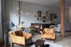 Salotto accogliente dal sapore industrial - Elementi vintage in un soggiorno di stampo industriale secondo le tendenze arredamento 2016.