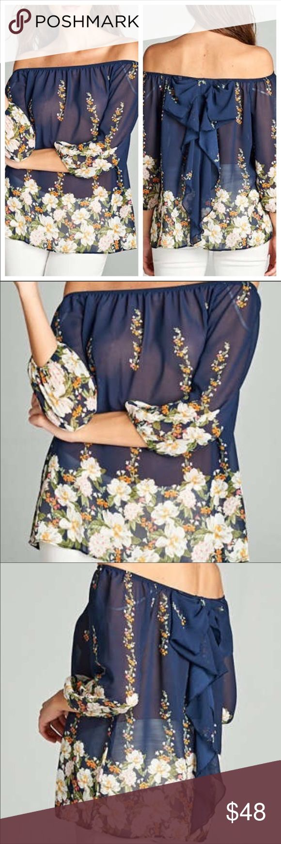 Stunning bow back top navy with florals NWT Stunning bow back top navy with florals NWT retails $100. Brand new for the summer 2017 fashion!  #fashionweek all purchases included one free week luxury fashion designer rental from Lavish Lend as well. Tops Blouses