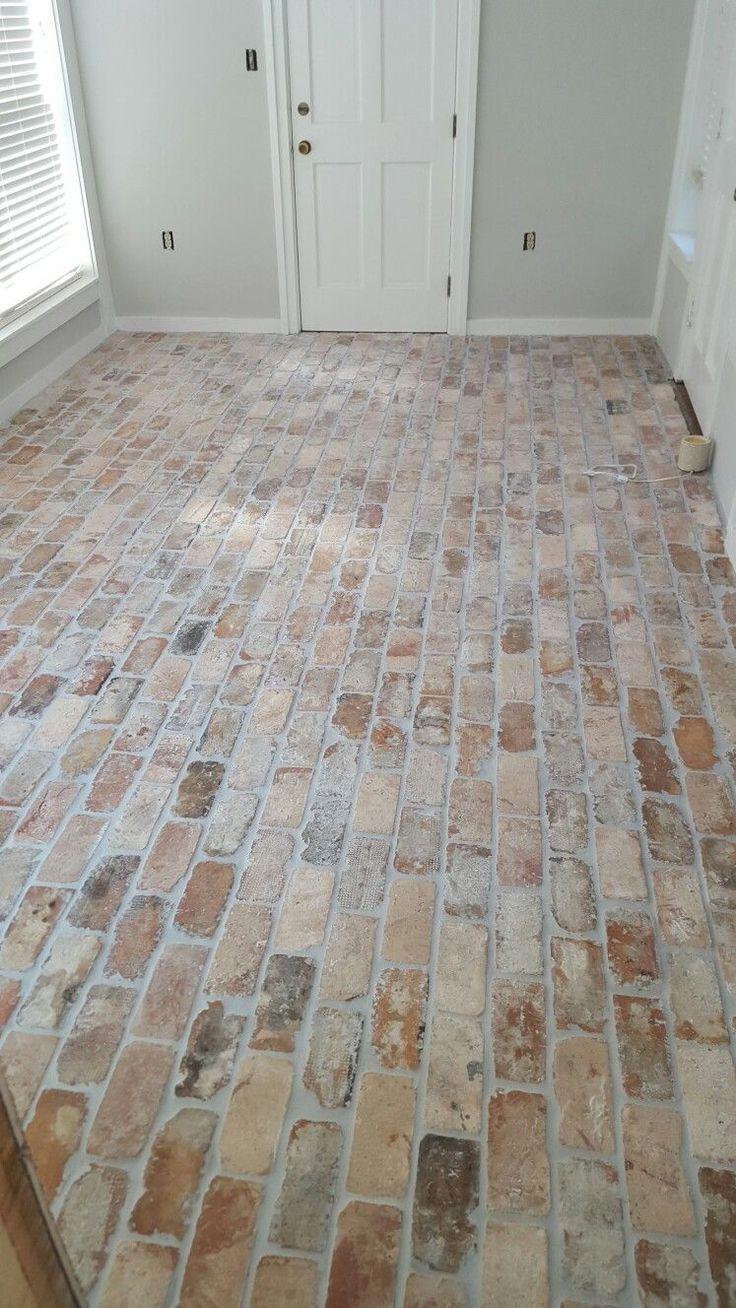 Gorgeous distressed brick flooring.