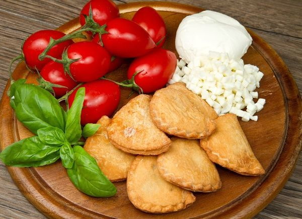 Italian Recipe: Panzerotti - Panzerotti are the speciality in Bari, a southern Italian city located on Puglia's coast. These fried pockets of dough are stuffed with all range of ingredients, sweet to savory. Classic fillings include salami, ham and ricotta, and chopped meat with mozzarella. The options are truly limitless, though. Chocolate, caramel, honey-filled panzerotti? Yes, please. Gruyère and prosciutto? Don't mind if we do. What stays the same is that light, flaky pastry crust.