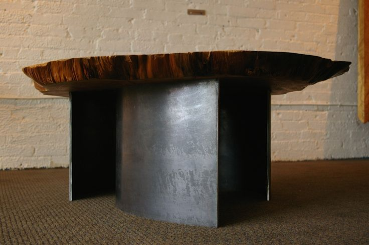 1970 Table [floor angle]: Aged cedar burl set on curved blackened hot rolled steel legs (18-inch and 24-inch diameter legs). This small collection of burls has been aging since the late 60's. Designed by Kirk Van Ludwig.