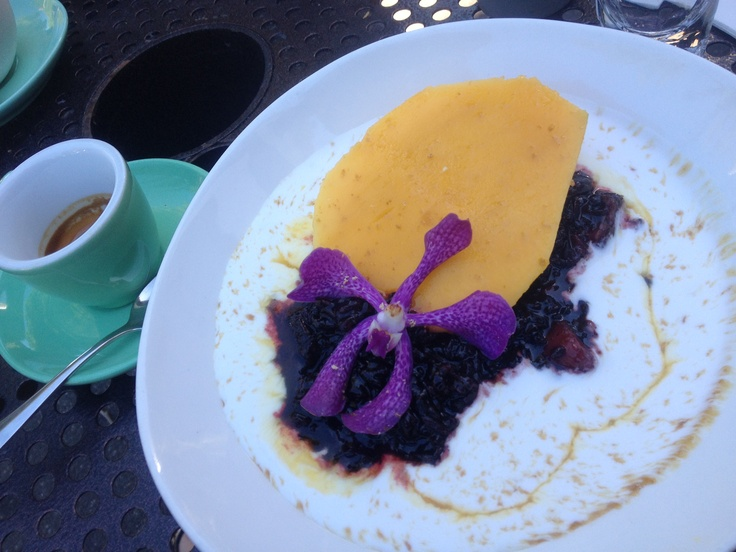 Organic Balinese black sticky rice with mango, salted coconut cream with a splash of palm sugar. At 20&6 espresso.   Pulut hitam ( awesome version). Surprisingly pairs well with fresh mango.