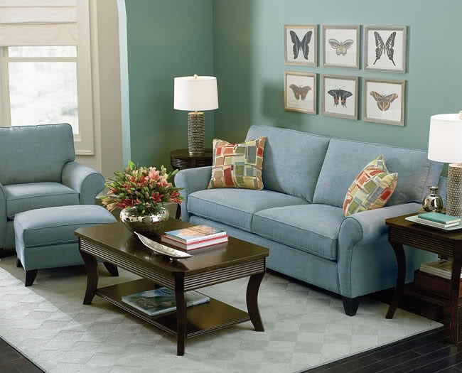 the bluegreen wall and light blue couch create a relaxing space with the cool