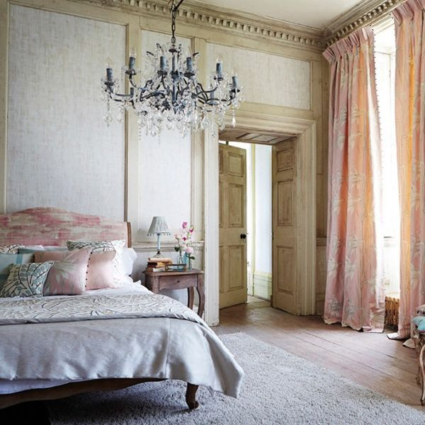 """Season 4 sees the start of the Roaring Twenties. Think decadent elegance: soft textured wallpaper, pretty French-style furniture, pale pinks and blues - and a statement chandelier.   [link url=""""http://www.harlequin.uk.com""""]Harlequin[/link]  [link url=""""http://www.houseandgarden.co.uk/homes/living-room""""]Over 100 living toom ideas to inspire[/link]"""