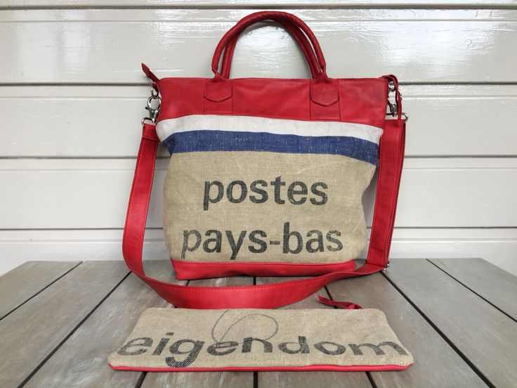 Shopper, made of an old used postbag and red leather and a separate small case. One side of the bag is red leather.
