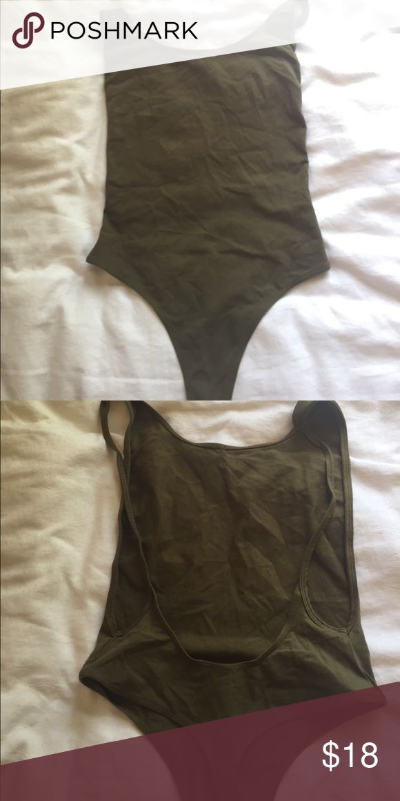 American Apparel bodysuit Never been worn NWOT bodysuit. Serious side boob and open back! Very cute! American Apparel Tops