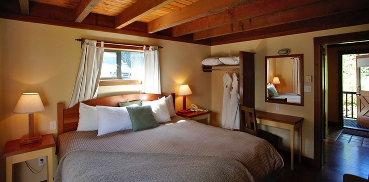 A cozy bed in one of our cabins.