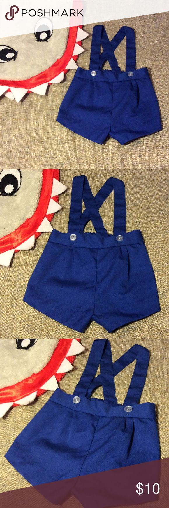 💙Baby Boy 3-6M Suspender Bloomer shorts💙 💙 Unbranded 3-6 Month Baby Boy Suspender Bloomer Shorts! 😍 Absolutely Adorable! In Perfect Condition! No Stains, Rips or Holes. Made of 65% Polyester 35% Cotton Made in the Philippines... ( Shark Blanket) Not included!! If you have any questions please feel free to ask. Also, Thank you for visiting my closet! Leave your posh name below so I can check out your closet as well. 👍🤗Thank you unbranded  Bottoms