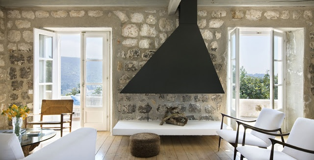 living room minimalist decor croatian croatia home coastline coast villa interior exposed limestone walls white furniture home furnishings