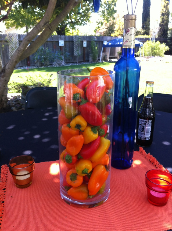 fiesta centerpieces for a party just fill a glass vase with chiles---so beautiful. popularwiththepoplins.blogspot.com