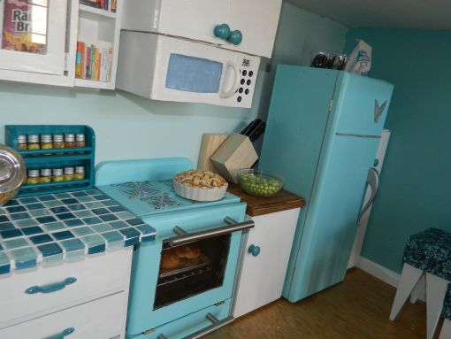 An American Girl doll house: A kitchen almost better than my real one! Who doesn't love to bake and cook in a well appointed kitchen?