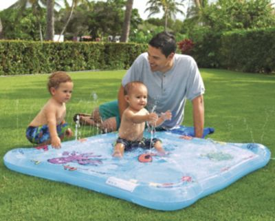 """Babies love cooling off in our gentle tide pool, with extra-soft sprayers to splash in and explore. As baby becomes more comfortable in the water, you can make the """"fountains"""" higher (just turn up the pressure of your garden hose). There's even a pat mat area with floating 3D fish. With fun undersea graphics (tickle a turtle; cover the whales' blow hole!). 50""""L x 50""""W. For ages 12 months and up. Designed by OneStepAhead! $22.95"""