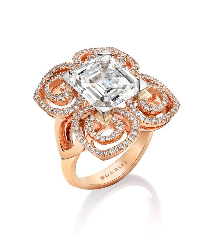 Peacock White and Rose Diamond Ring.  A dazzling, artistic ring from Boodles' Peacock collection, set with a central emerald cut diamond of 4.08ct and a further 0.54ct of round-brilliant cut diamonds in platinum and 18ct rose gold