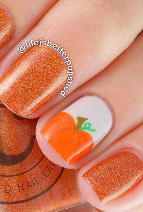 This small pumpkins nail art is super chic and easy to copy. The matching glittery orange polish rounds out this fall-ready mani.