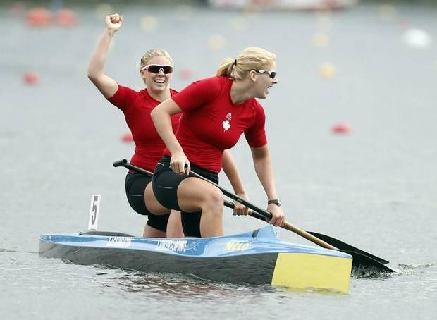 Canada's Laurence Vincent-Lapointe, front, and Sara-Jane Caumartin celebrate after winning the C2 Women 500m final during the Canoe Sprint World Championships in Duisburg, Germany, Sunday, Sept. 1, 2013. (Frank Augstein/AP)