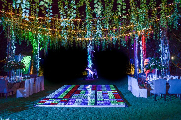 Beautiful Garden reception here at Dreams Tulum Resort & Spa! Talk with the coordinator to see what other types of fun dancefloors we have available! #DestinationWedding #WeddingDecor #DreamsWedding #DreamsTulum #SecretGarden #Hangingvines #GreenWedding