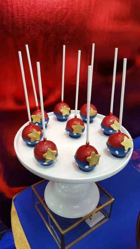 Awesome cake pops at a Wonder Woman birthday party! See more party ideas at CatchMyParty.com!