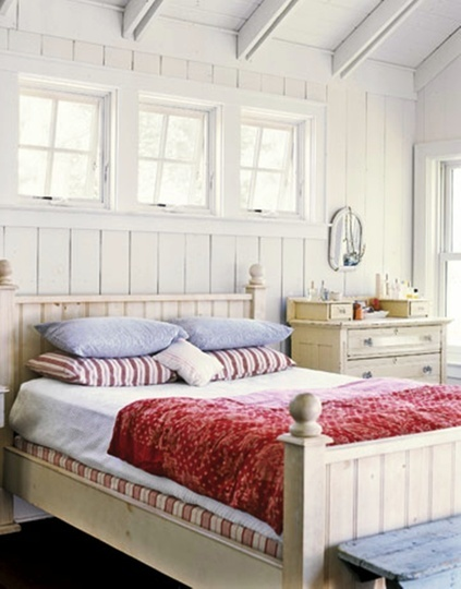 Would be a pretty lakehouse bedroom - red and white, panelled walls...great little chest of drawers!