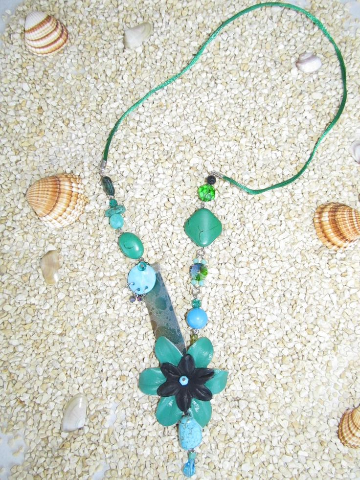Handmade necklace (1 pc)  made with leather flowers, green metal look cord, leather piece, gemstones, glass beads and metal with green crystal.